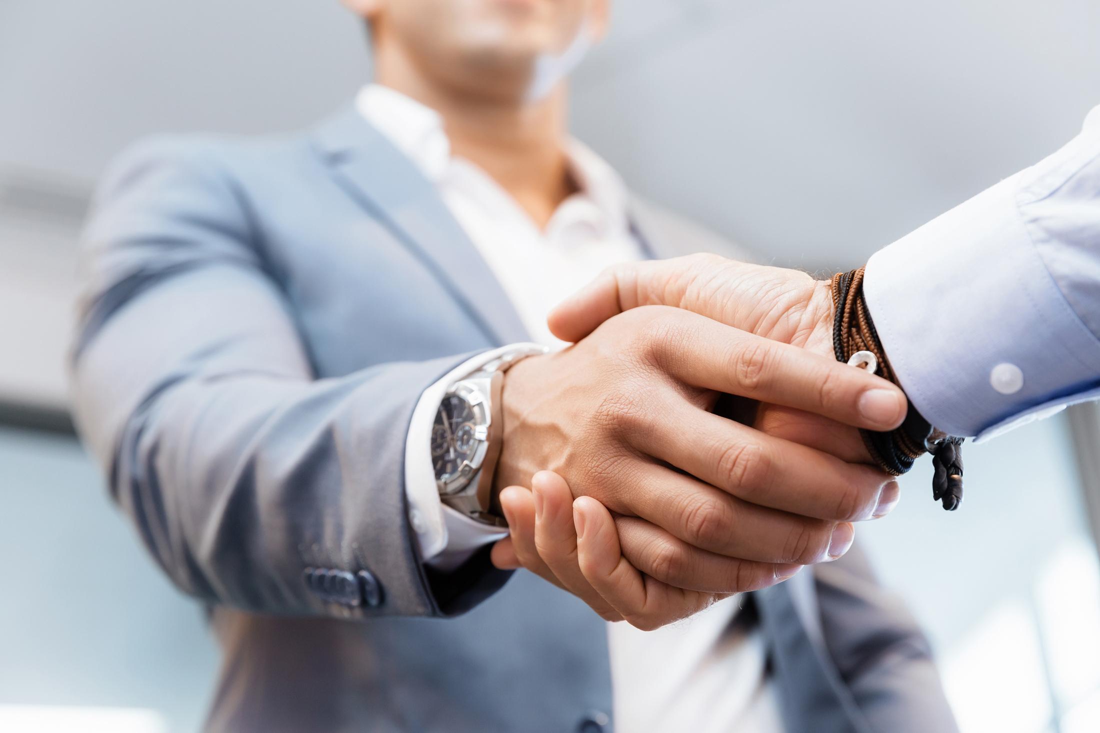 Handshake of businessmen greeting each other